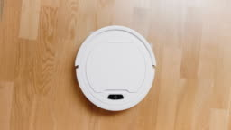 A small robot vacuum cleaner at home