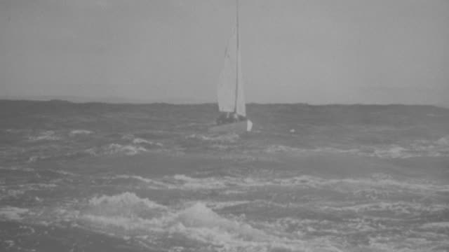 MS TS Small sailboat moving in ocean