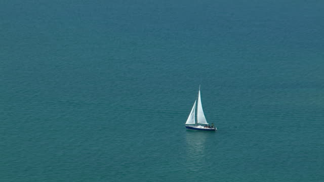 Small sailboat off the coast of Antigua's Long Island in the Caribbean.