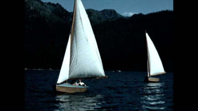 small sailboat on lake in washington state - mt rainier national park stock videos & royalty-free footage