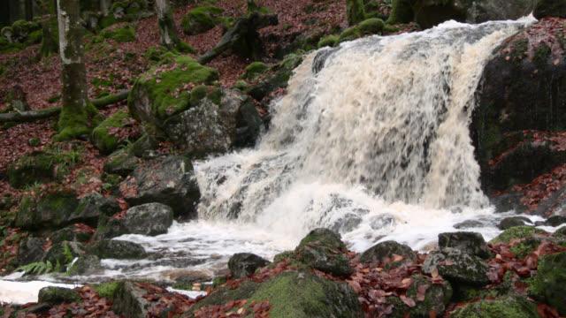 Small Scottish waterfall swollen by heavy rain in late autumn
