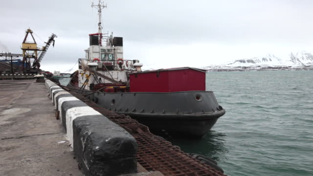 a small ship at the port of barentsburg, a russian mining settlement on svalbard archipelago - 1932 stock videos & royalty-free footage