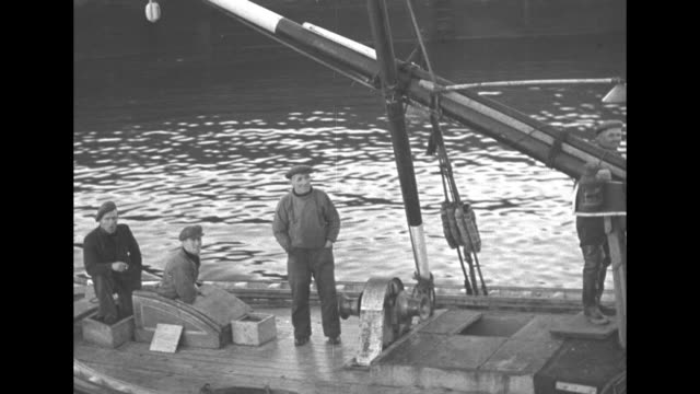 small ship in harbor / rescue crew on deck of fishing boat / cu name on boat day spring / cu three fishermen of rescue crew that aided downed german... - fluss firth of forth stock-videos und b-roll-filmmaterial
