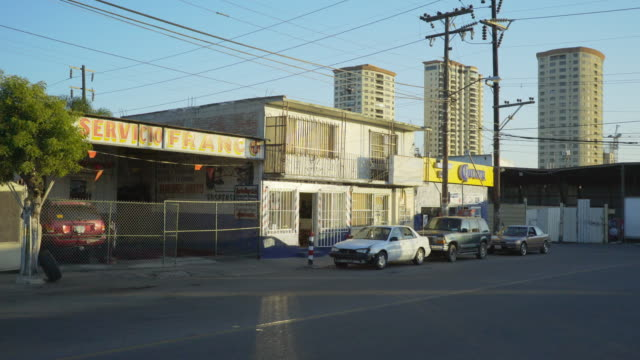 small shops with high-rises in tijuana - liquor store stock videos and b-roll footage