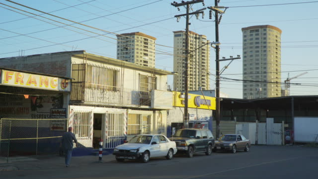 small shops with high-rises in tijuana - security bar stock videos and b-roll footage