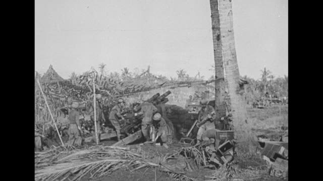 Welcome to Philippines / American troops firing field guns from under net camouflage a gun on tank fires / Men enter hut with a dead body on the...