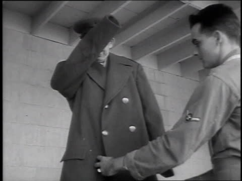 1951 montage small soldier at lackland air force base trying on very large coat and shoes / san antonio, texas, united states - lackland air force base stock videos and b-roll footage
