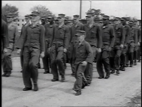 1951 montage small soldier trying to keep up with marching maneuvers / san antonio, texas, united states - lackland air force base stock videos and b-roll footage