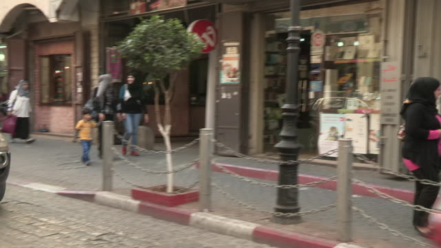 small street and pedestrians, ramallah, palestine - palestinian territories stock videos and b-roll footage