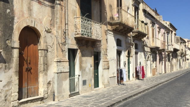 A small street in Noto with laundry, Sicily