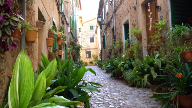 small street in valldemosa, panning - majorca stock videos & royalty-free footage