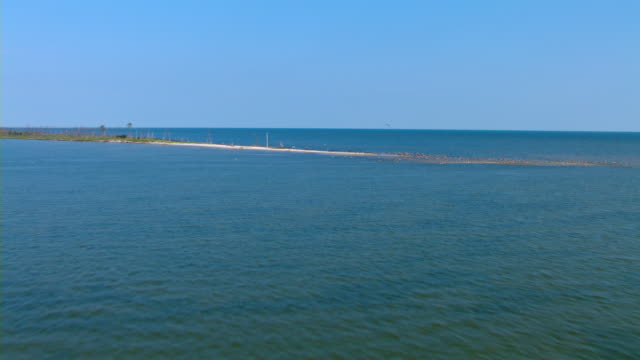 A small strip of land juts in the Gulf from the Gulf Islands National Seashore.