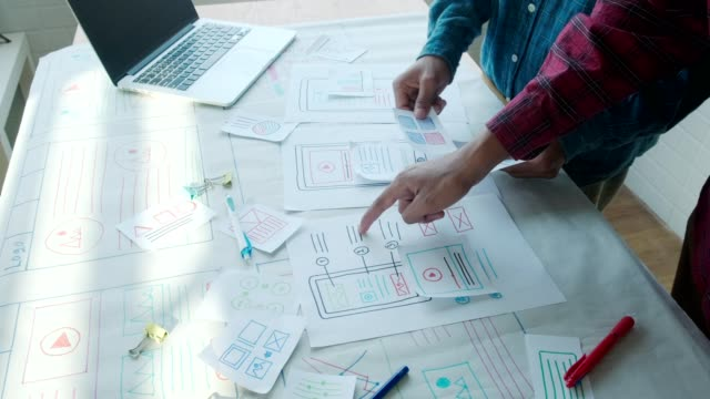 small team of young ux ui designers creating mobile app layout website - prototype stock videos & royalty-free footage