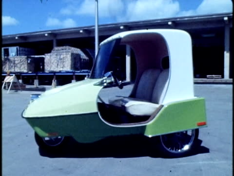 1975 montage small three-wheeled electric car prototype in parking lot/ hawaii islands, usa/ audio - salesman stock videos and b-roll footage