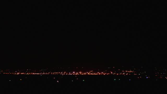 ws small town in mojave desert illuminated at night / california, usa - distant stock videos and b-roll footage