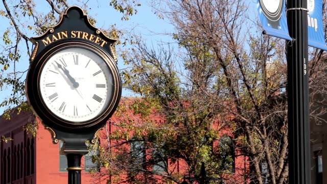 small town main street clock - high street stock videos & royalty-free footage