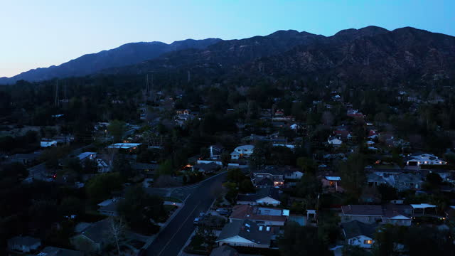 small town of la canada california at dusk - drone shot - town stock videos & royalty-free footage
