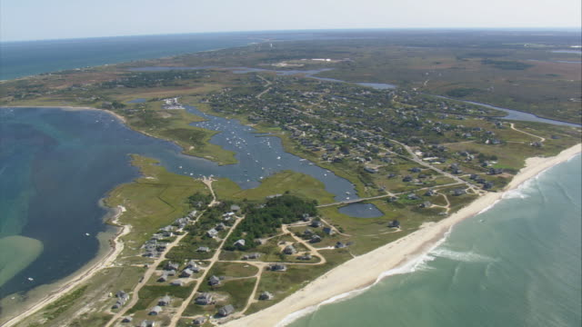 aerial small town on jagged shoreline with narrow sandy beaches, meandering lagoons and inlets, and gently lapping waves / oak bluffs, massachusetts, united states - oak stock videos and b-roll footage