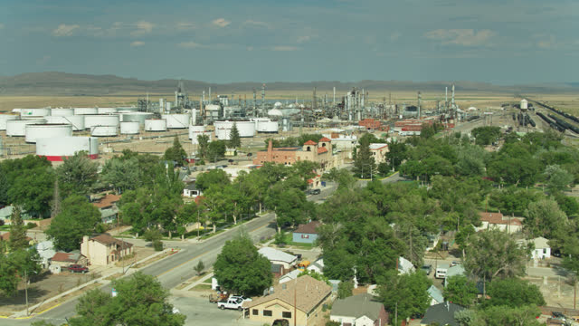 small town with big oil refinery - drone shot - wyoming stock videos & royalty-free footage