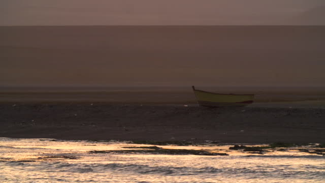 small traditional fishing boat alone on shore - island stock videos & royalty-free footage