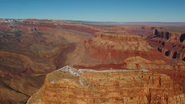 A small trail of snow dusts a ridge of the Grand Canyon.