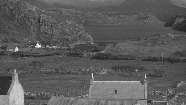 1944 pan small village and fenced in crofts on highlands by the sea / achriesgill, scotland, united kingdom - achriesgill stock videos & royalty-free footage