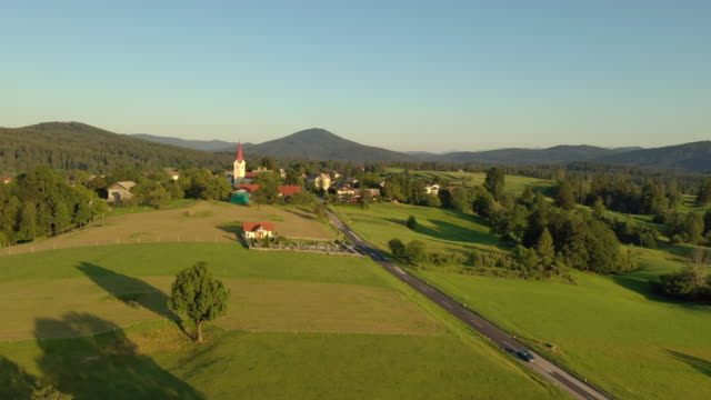 aerial small village in the countryside - chapel stock videos & royalty-free footage