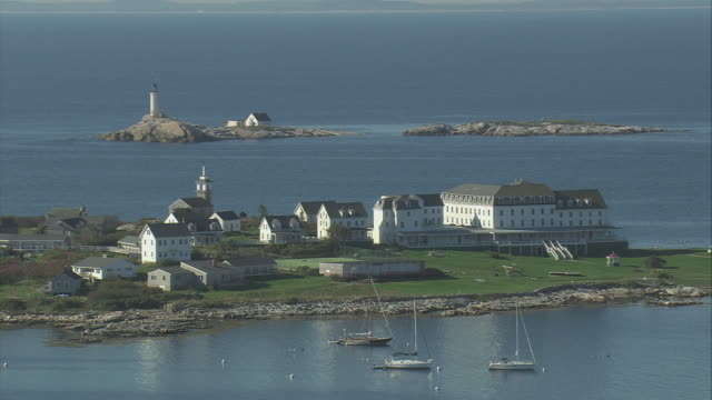 aerial small village on isles of shoals, anchored boats and white island light beyond / new hampshire, united states - isles of shoals stock videos & royalty-free footage