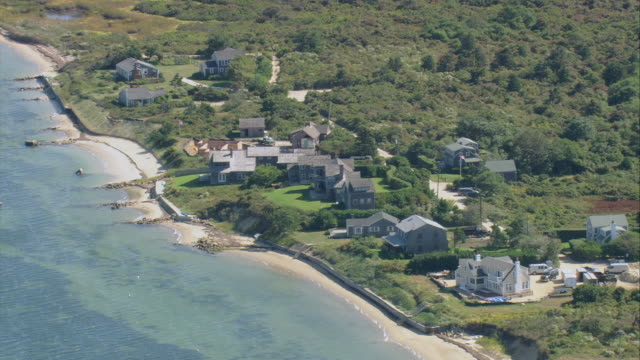 aerial small village spread along narrow sandy beach / nantucket, massachusetts, united states - massachusetts stock-videos und b-roll-filmmaterial