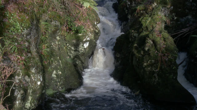 Small waterfall in rural Dumfries and Galloway south west Scotland