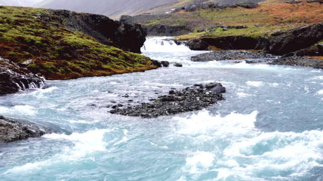 small waterfall on remote location in iceland - small stock videos & royalty-free footage
