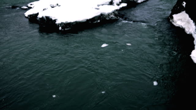 vídeos de stock e filmes b-roll de small waterfalls surrounded by ice and snow - remote location