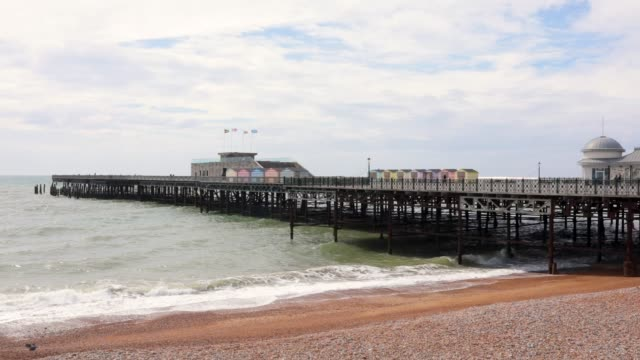 small waves lap the shore by hastings pier on april 27 2018 in hastings england a group of local residents are attempting to raise £1 million in... - pier stock videos & royalty-free footage
