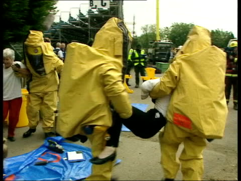 Key workers vaccinated ITN Soldiers and emergency workers in biological and chemical protection suits taking part in exercise