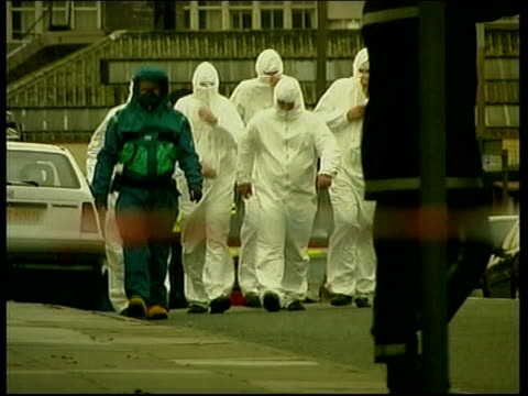 london ext group of officials in biochemical protection suits along during chemical/biological attack exercise emergency workers in protective suits... - biochemistry stock videos & royalty-free footage