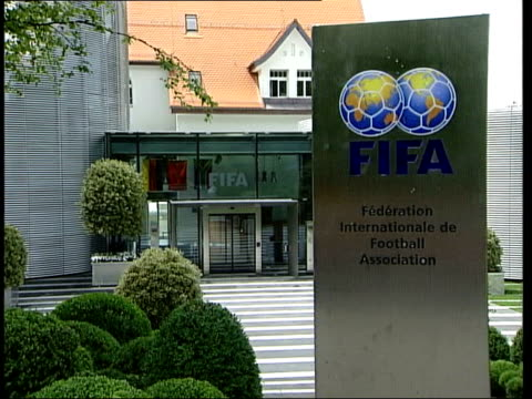 smart ball demonstrated to fifa representatives; c07059701 switzerland: zurich: ext gv fifa headquarters - fifa stock videos & royalty-free footage