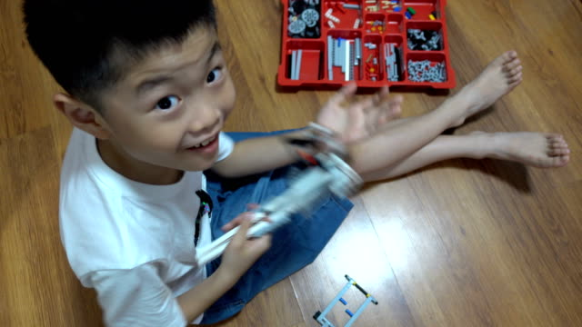 smart boy building robot blocks indoors - game show stock videos & royalty-free footage