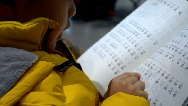 smart boy studying in waiting room - chinese script stock videos & royalty-free footage