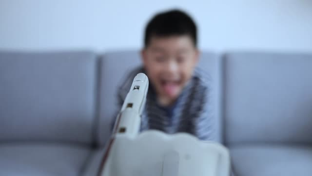 smart boy berührt roboterfinger - human finger stock-videos und b-roll-filmmaterial