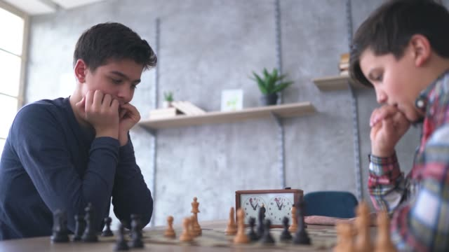 smart boys playing chess - brother stock videos & royalty-free footage