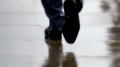 smart city shoes, businessmen walking in rain. feet only, rear view. - human foot stock videos & royalty-free footage
