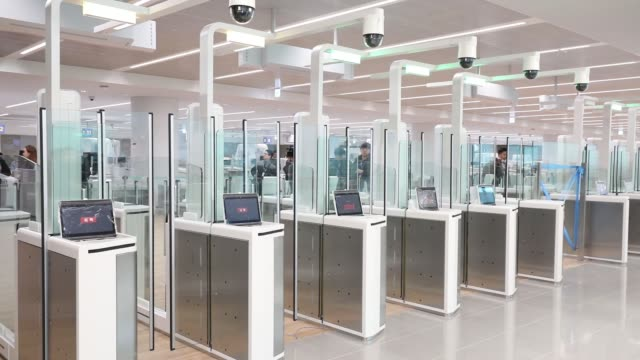 Smart entry service counters stand inside the nearly completed terminal 2 building during a media preview at Incheon International Airport in Incheon...
