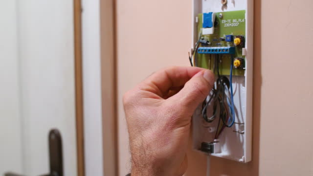 smart home. close-up of a male electrician hands working on an automation system equipment. engineering, experienced professional. - safety equipment stock videos & royalty-free footage