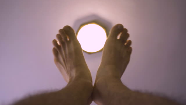 smart home. turning on a led light bulb lamp, ceiling lamp. - accendere e spegnere video stock e b–roll