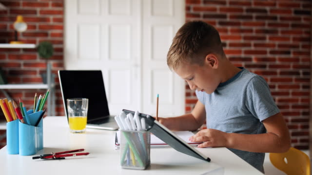 smart little boy does homework in her room - e learning stock videos & royalty-free footage