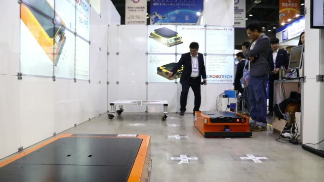 a smart logistics robot from marorobot tech co ltd is demonstrated at the company's booth during the robotworld 2017 industry show in goyang south... - goyang stock videos and b-roll footage