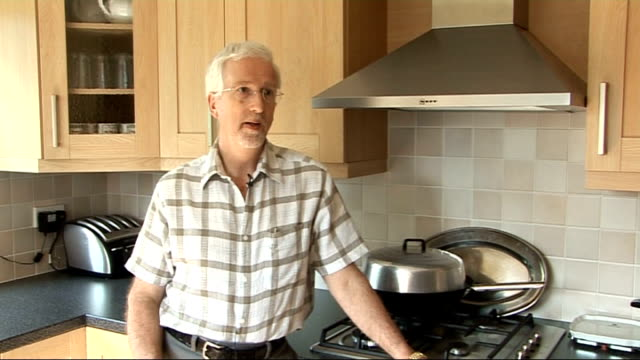 'smart meters' to be fitted in every uk home by 2020 england int lloyd matthews cooking on gas oven in his kitchen lloyd matthews interview sot hands... - tea kettle stock videos & royalty-free footage