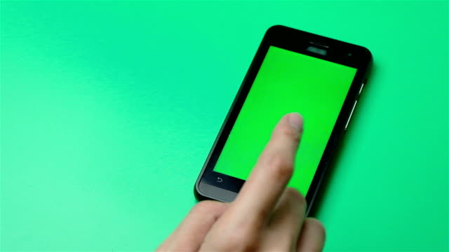 Smart phone green background with blank green screen