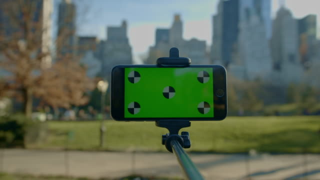 Smart phone green screen moving around Central park NYC