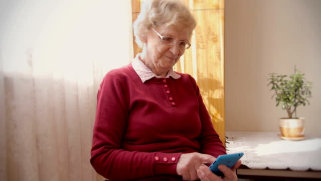 smart phone senior - grandmother stock videos & royalty-free footage